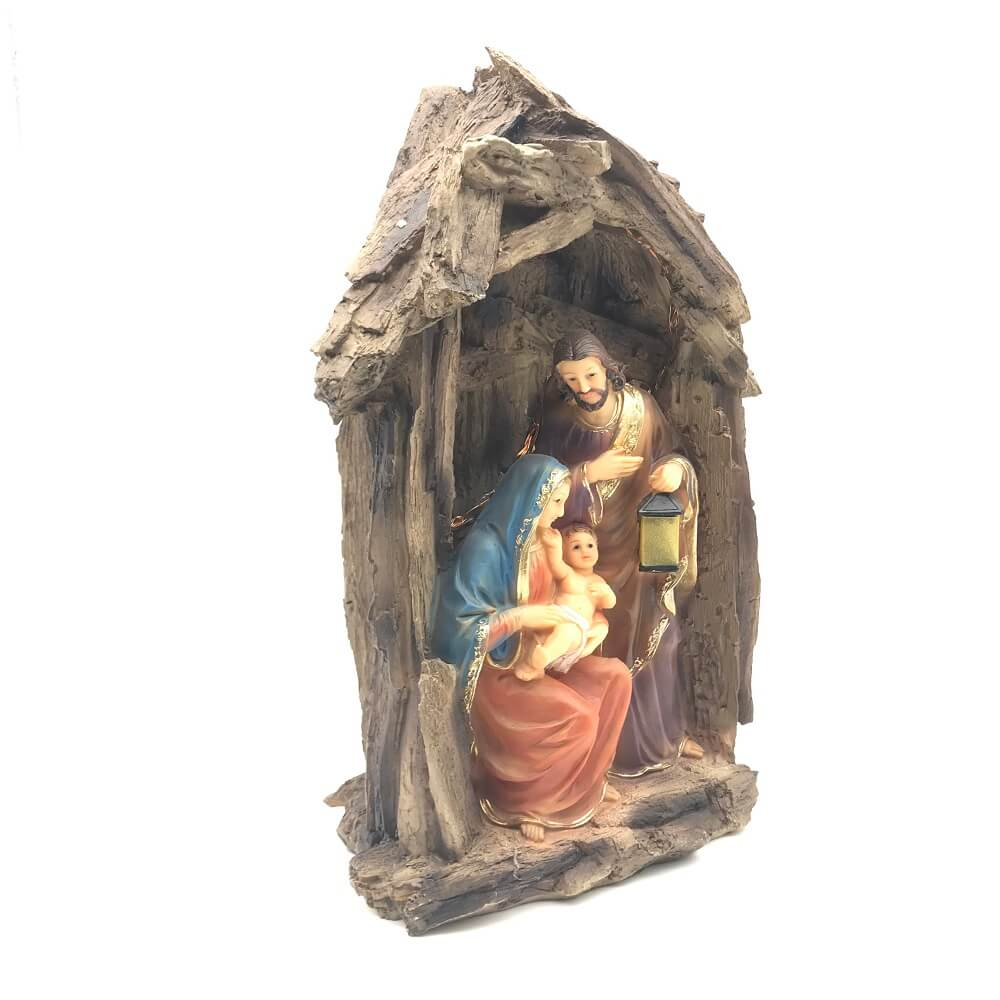 Presépio Da Sagrada Família No Tronco Com Luz