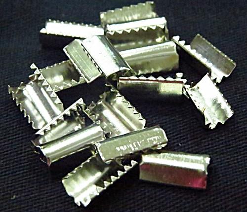 terminal p/ elastico niquel -50 peças-tan020