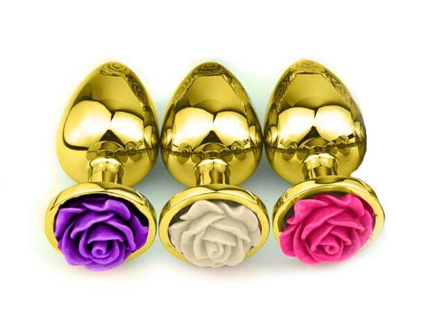 Plug Anal Grande de Alumínio Dourado com Flor Lapidada em sua Base