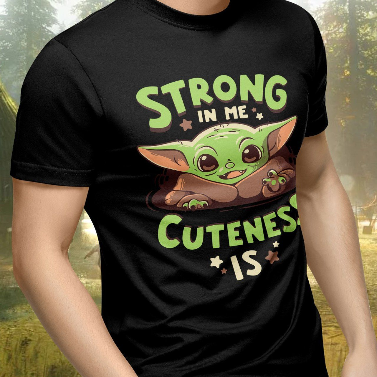 "Camiseta Unissex ""Strong In Me Cuteness Is"" Baby Yoda (The Child): The Mandalorian (Star Wars)"