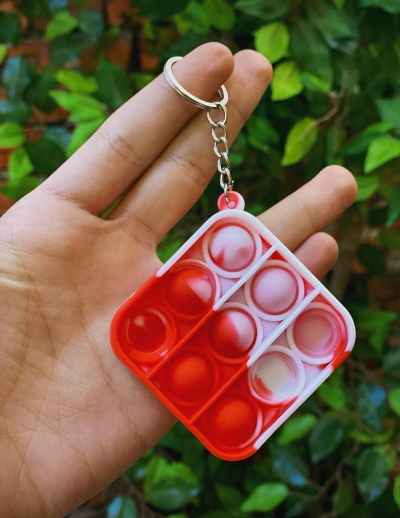Chaveiro Brinquedo Anti Estresse Pop It Fidget Pop Tube Stress Ball Wacky Track SquishMallow Bubble Bolha Quadrado Vermelho Sensorial de Alívio de Stress Tie Dye