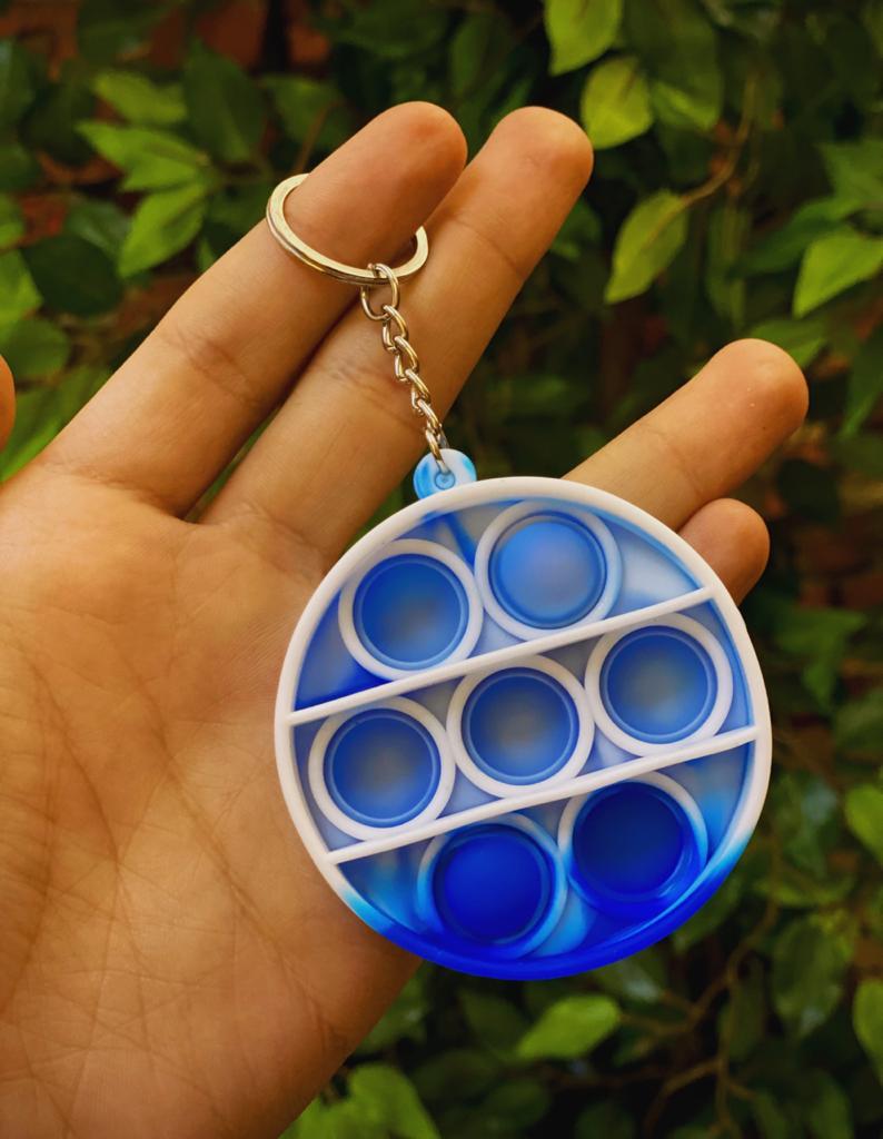 Chaveiro Brinquedo Anti Estresse Pop It Fidget Pop Tube Stress Ball Wacky Track SquishMallow Bubble Bolha Círculo Azul Sensorial de Alívio de Stress Tie Dye