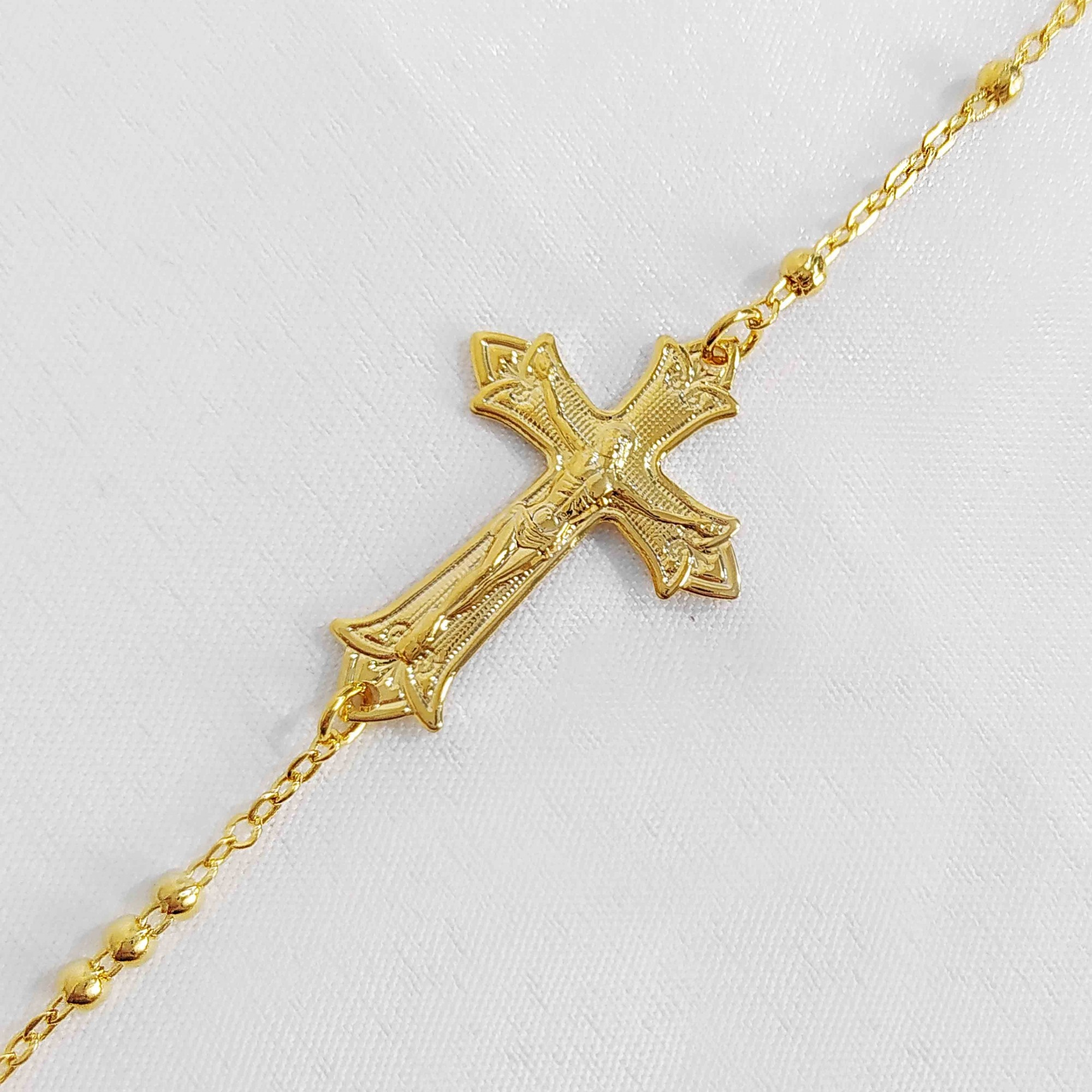 Pulseira Cruz Jesus em Relevo Folheado a Ouro 18k