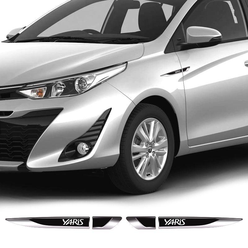Par De Aplique Lateral Yaris Hatch/Sedan Emblema Resinado