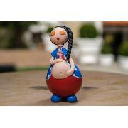 Boneca grávida encantada em cabaça vermelho olhos fechados