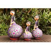 Trio de bonecas em cabaça lilás