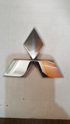 Emblema Dianteiro Mr598504 Mitsubishi outlander 06/12