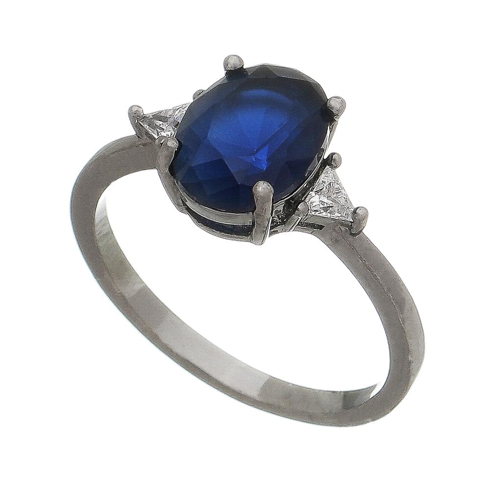 Anel com Cristal Azul e Triângulo Laterais de Pedra Zircônia Ródio Branco