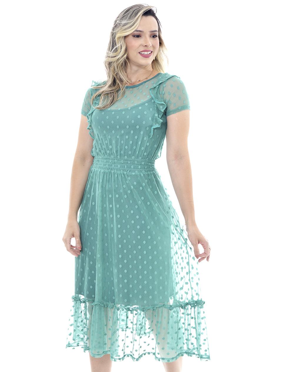 vestido em tule de poas, modelagem levemente solta