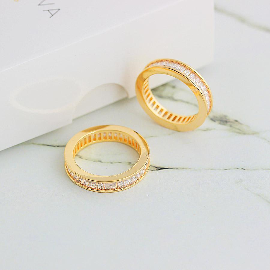 anel aparador de aliança zircônia baguete dourado