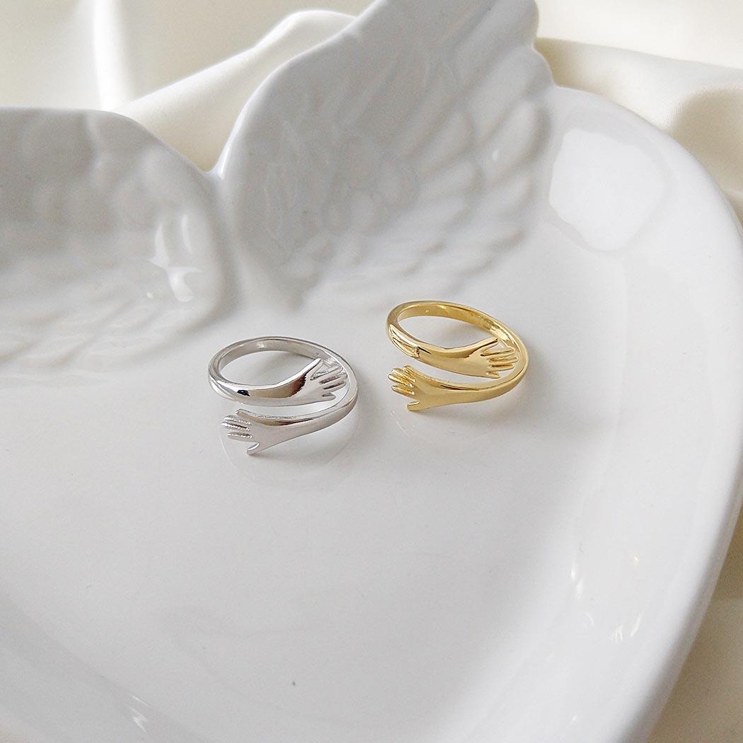 anel do abraço hug mão regulável dourado