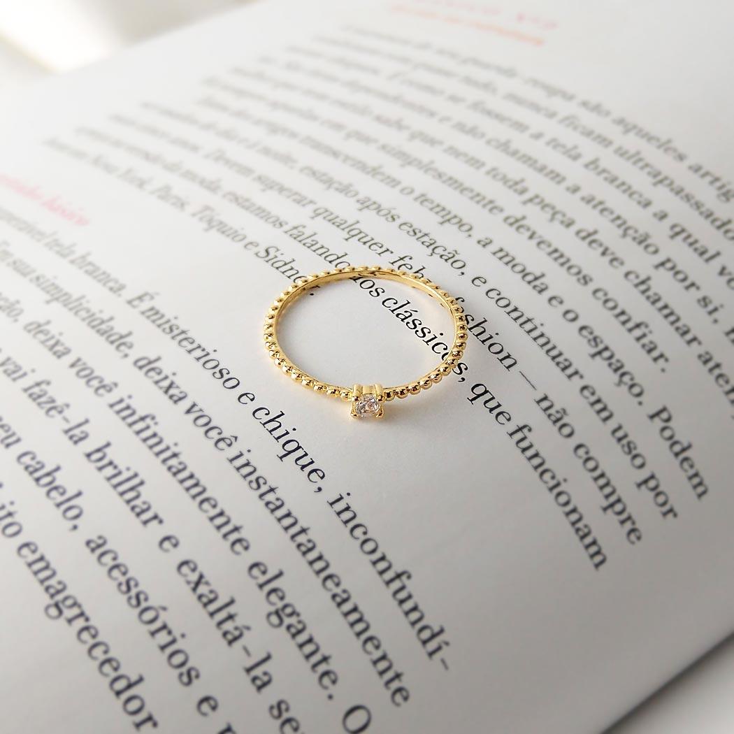 anel solitário bolinhas zircônia dourado