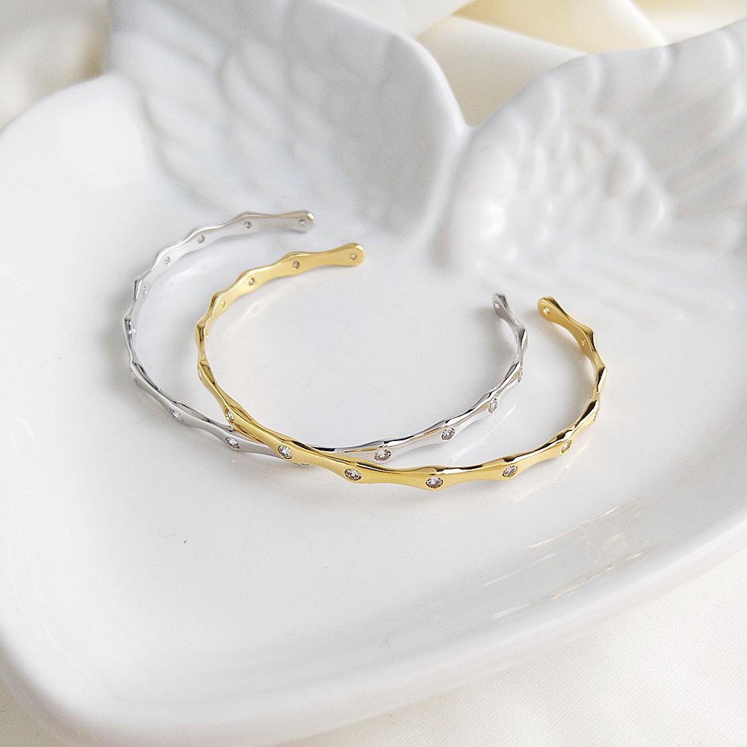 bracelete rígido zircônias curvas dourado