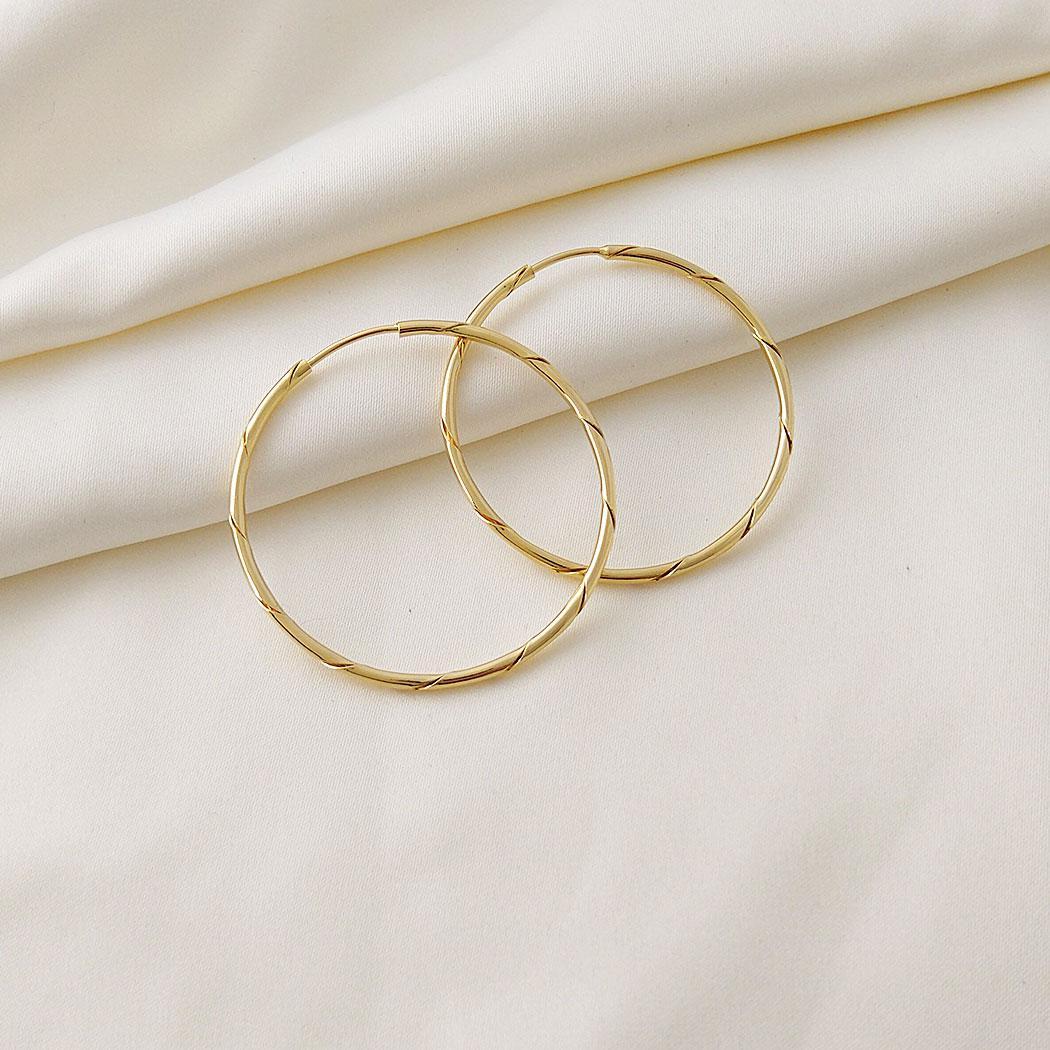 brinco argola torcida 40 mm passante dourado