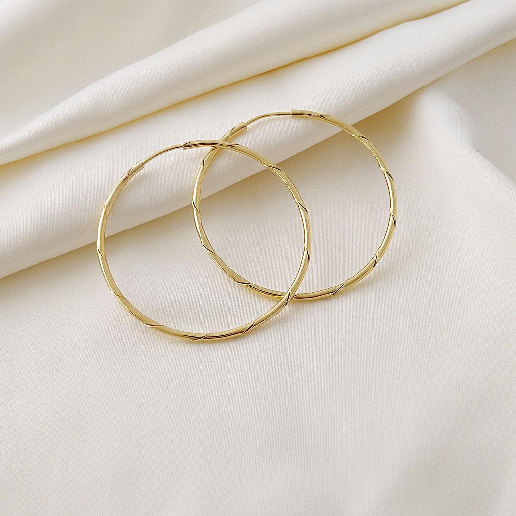 brinco argola torcida 45 mm passante dourado
