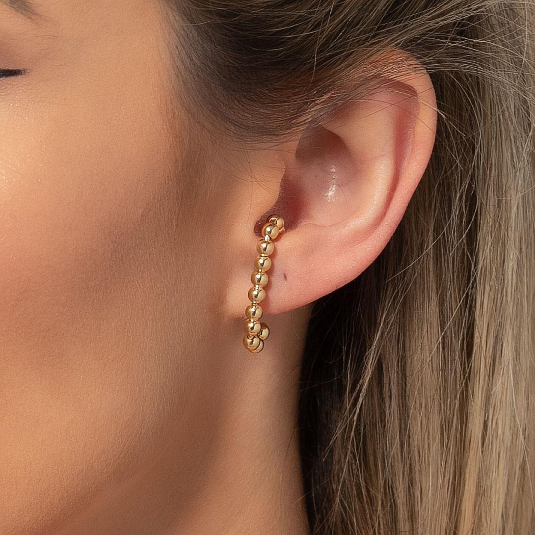 brinco ear hook bolas dourado