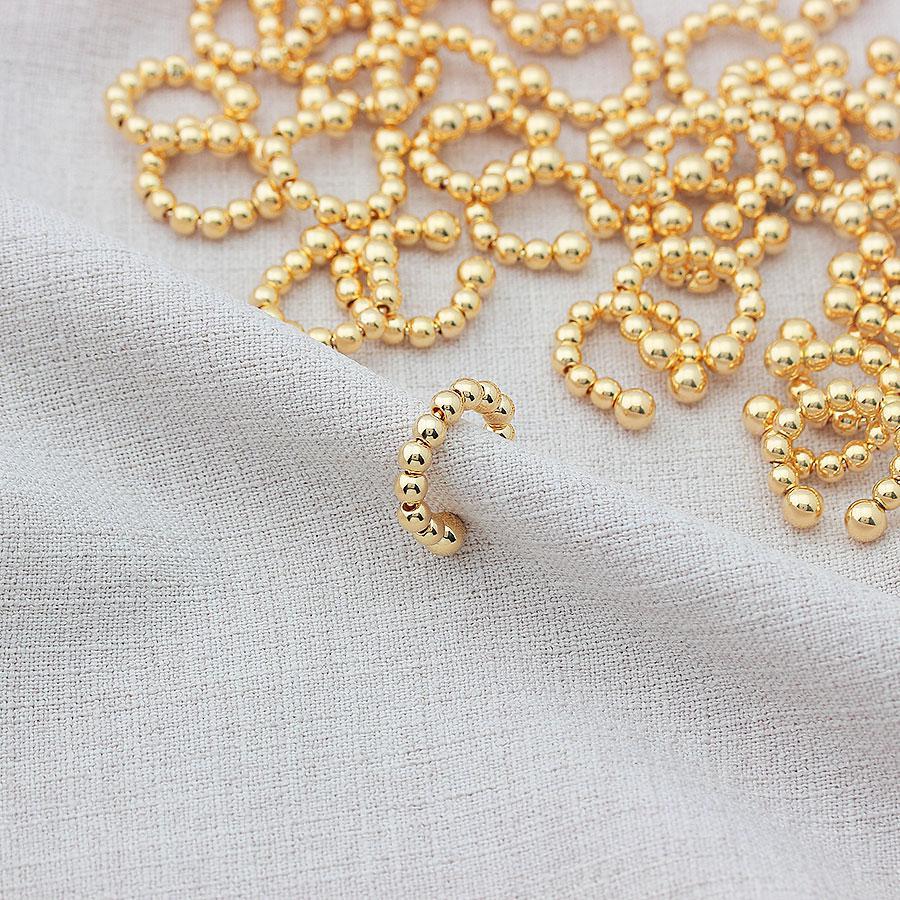 brinco piercing bolas sem furo dourado