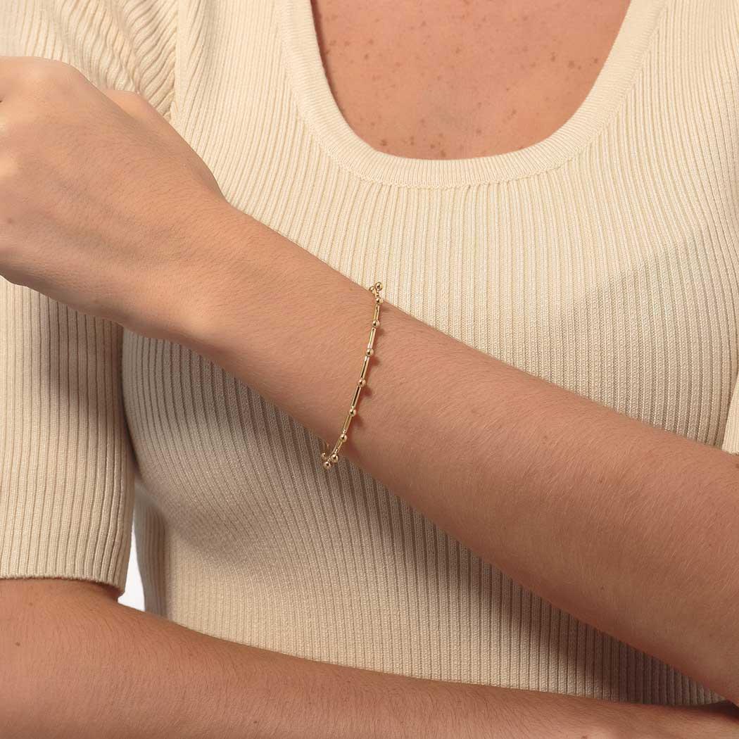 pulseira bracelete rígido bolas dourado