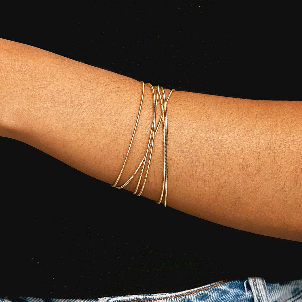 pulseira corda violão voltas dourada