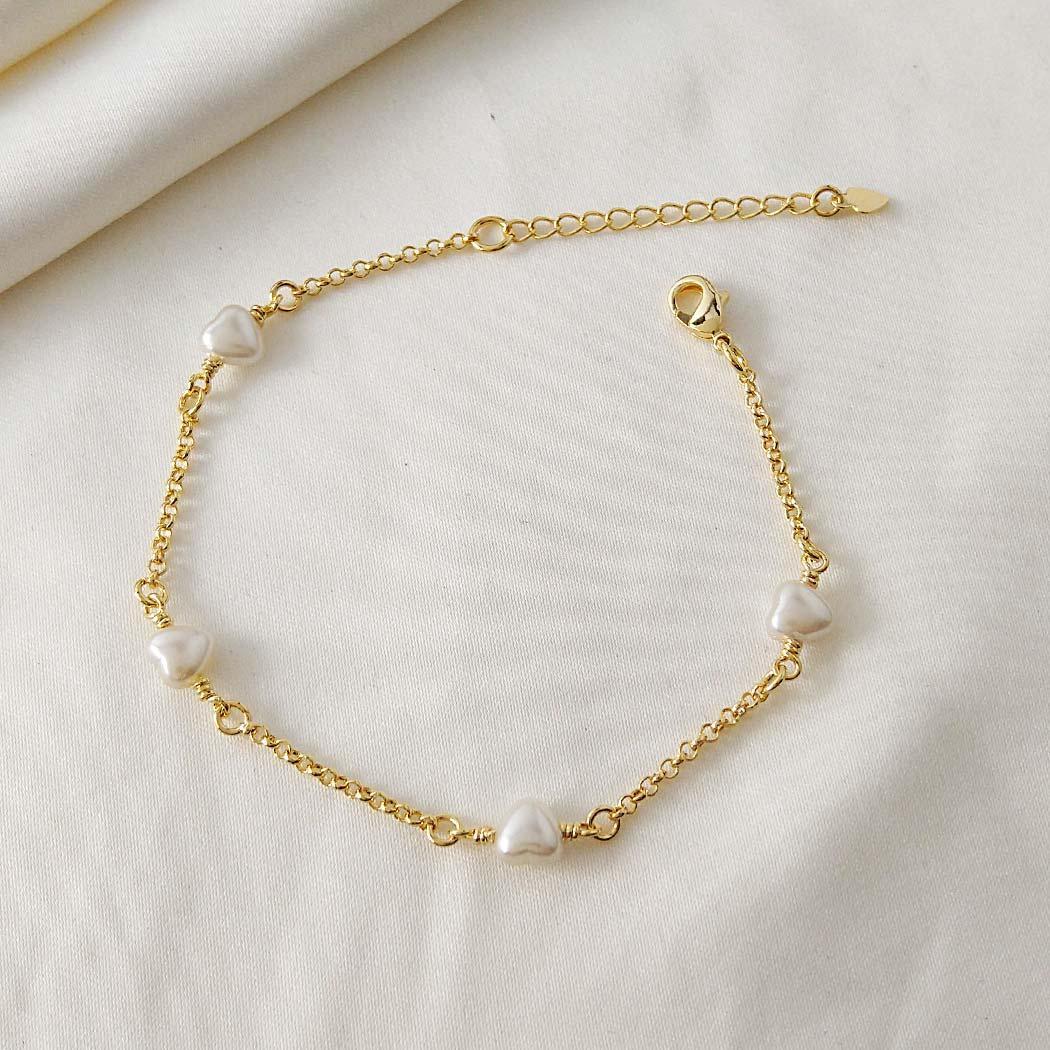 pulseira pérola coração dourada