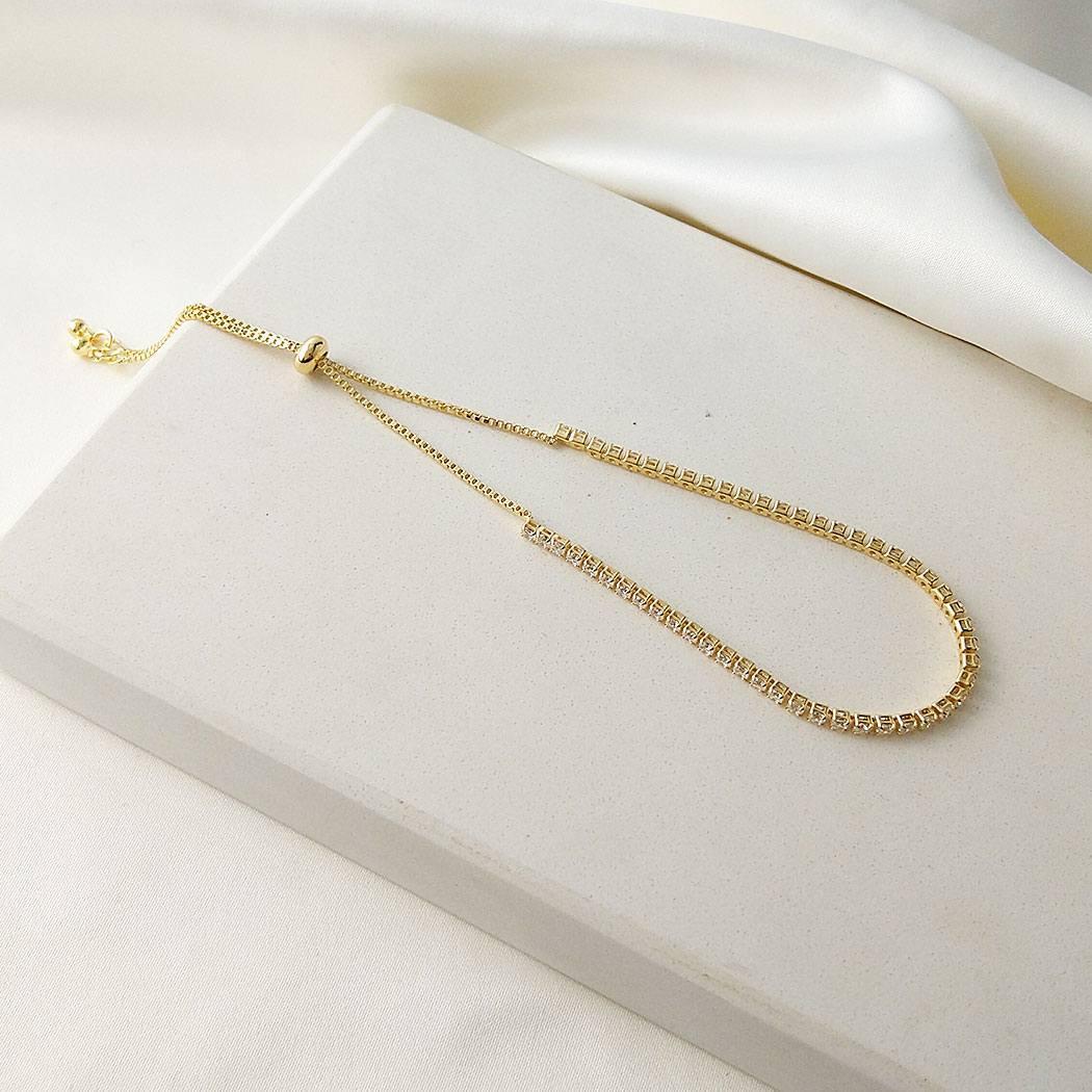 pulseira regulável zircônias dourada